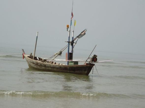 Long tail with fisherman boat