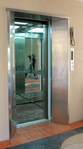 งานประตูลิฟต์แบบกระจก