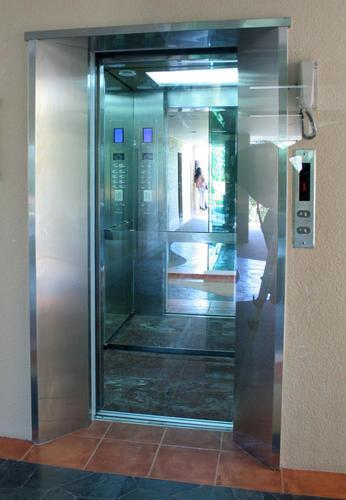 งานประตูลิฟต์กระจก
