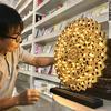 ธรรมจักรไม้-พ่นสีทองประดับไฟ-ขนาด49x45เซนติเมตร