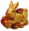 กระต่ายทองมุกนอนถือก้อนทอง